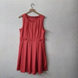 ELLE 16 Coral Sleeveless Dress with Pleated Skirt
